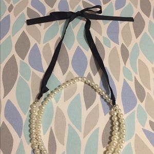 Faux pearl necklace with black ribbon